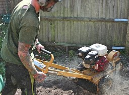 Arborist Dane Pugh setting about Grinding out this Stump using the Rayco Grinder thumb
